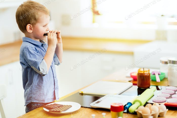 Toddler preparing food in kitchen