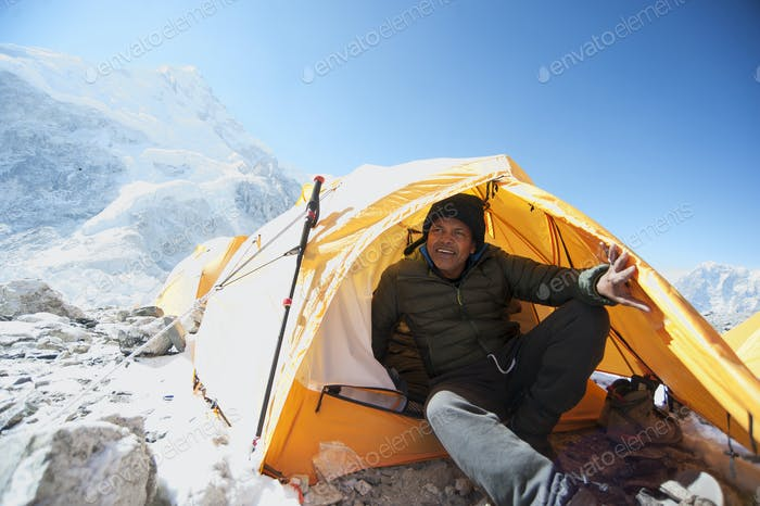 Man sitting in base camp tent in the Himalayas