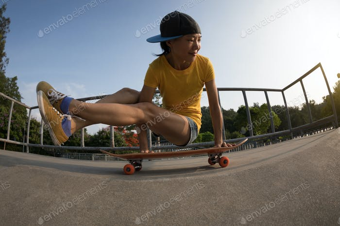 Practice yoga on skateboard at skatepark