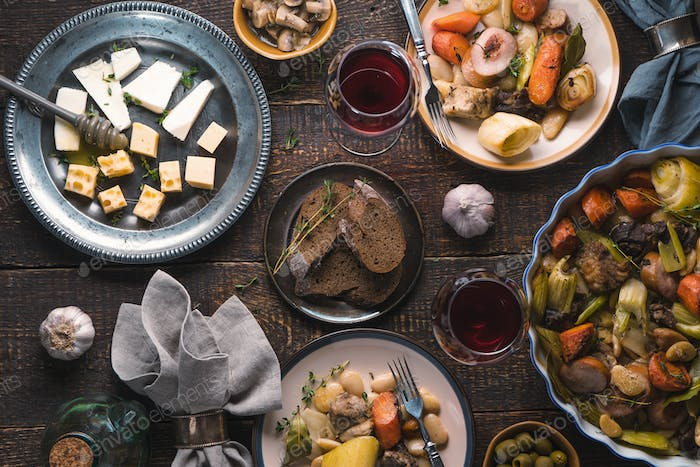 Feast with kasul, cheese, bread, olives and wine