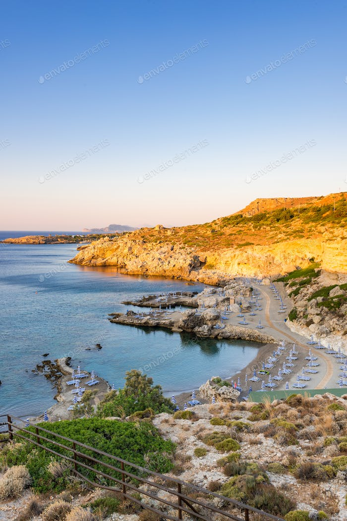 Sunrise at Beach in Cliffs with Sun Beds  and Mediterranean Sea