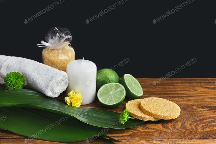 Spa composition with lime, towel and candle