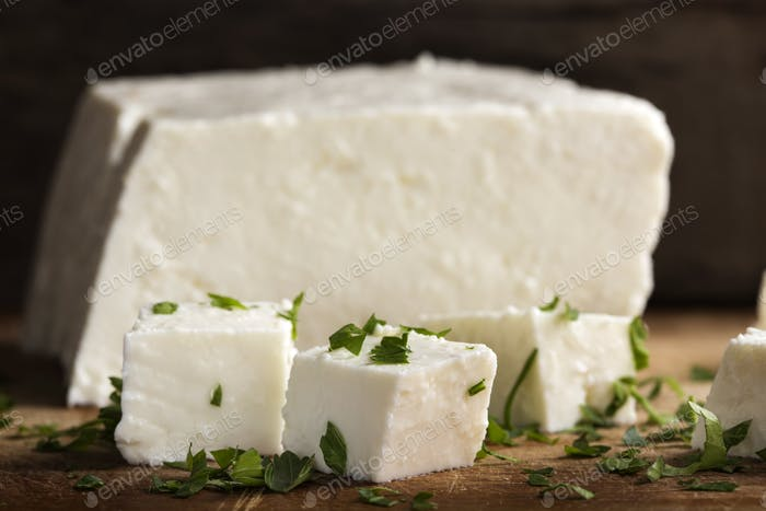 pieces of cheese with parsley leaves