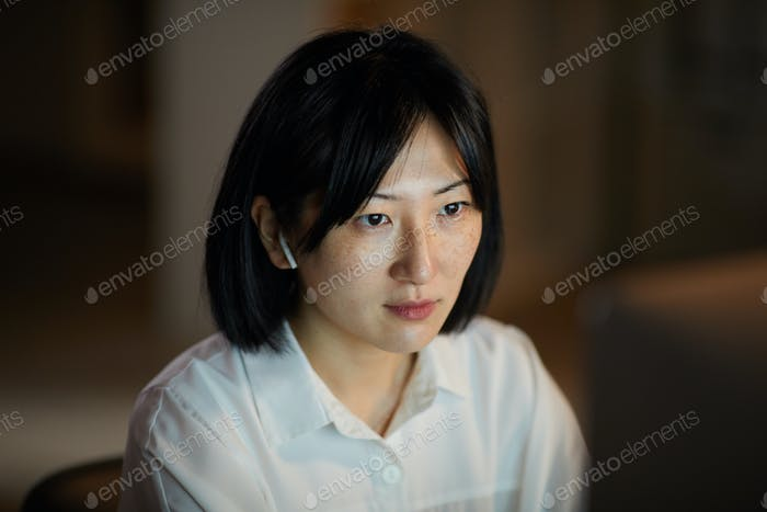 Asian woman working in the evening