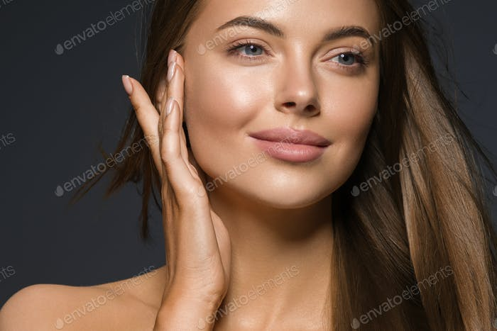 Smooth beauty woman long hair brunette female model natural makeup beautiful girl dark background
