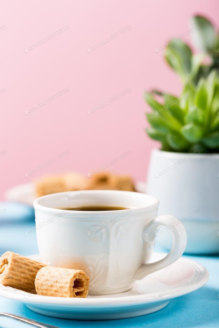 Two cups of coffee with wafer rools