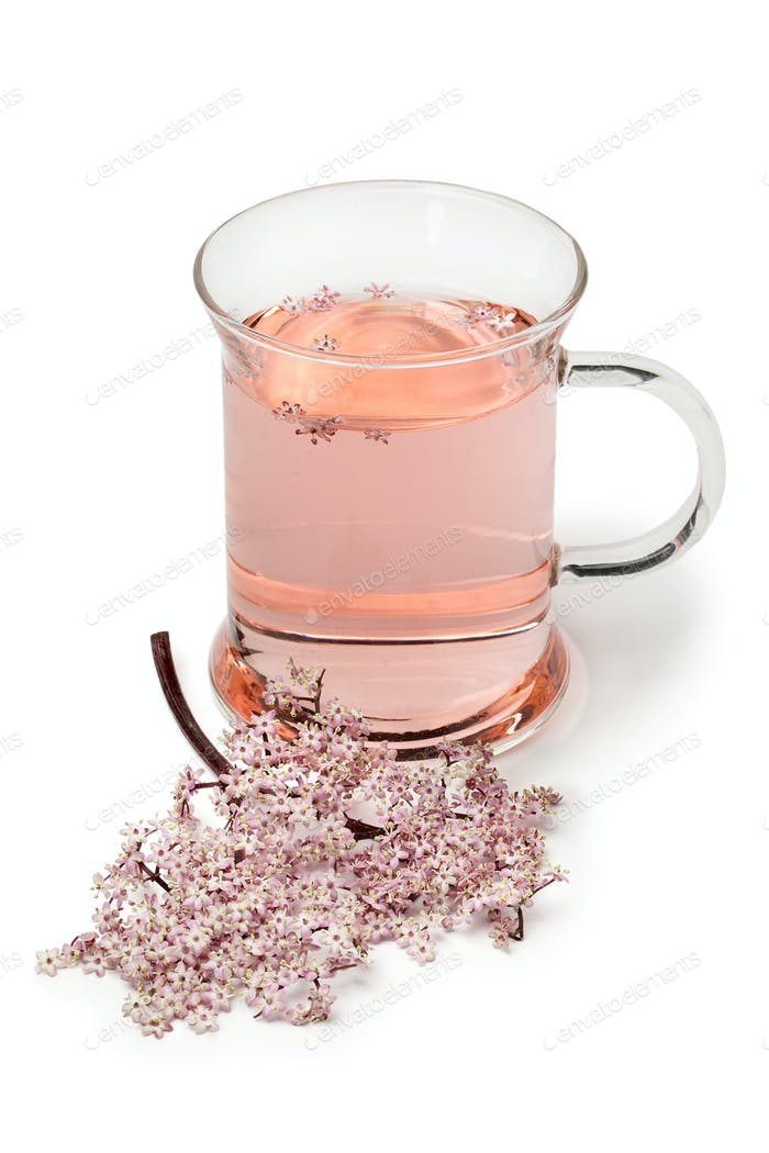 Glass with pink elderberry blossom tea