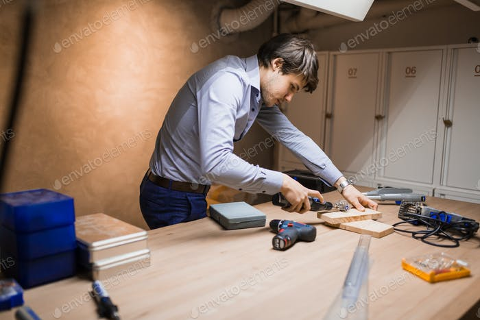 Handyman working with wood