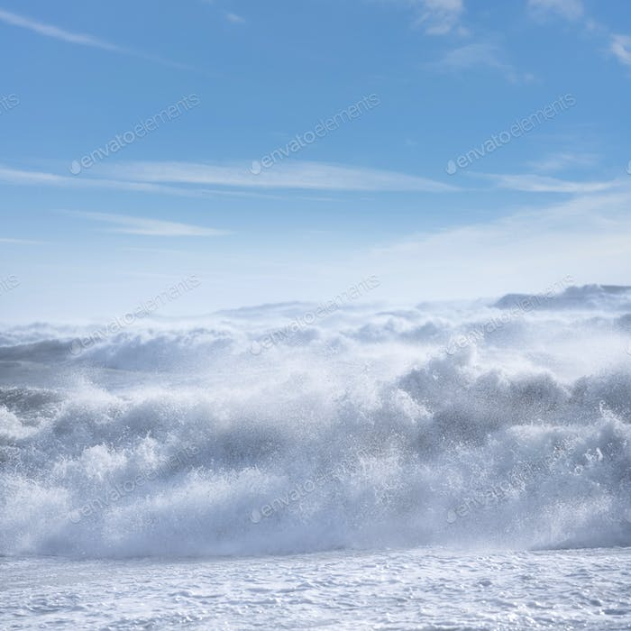 Stormy sea with waves and foam during wind storm. Tyrrhenian Sea, Tuscany, Italy.