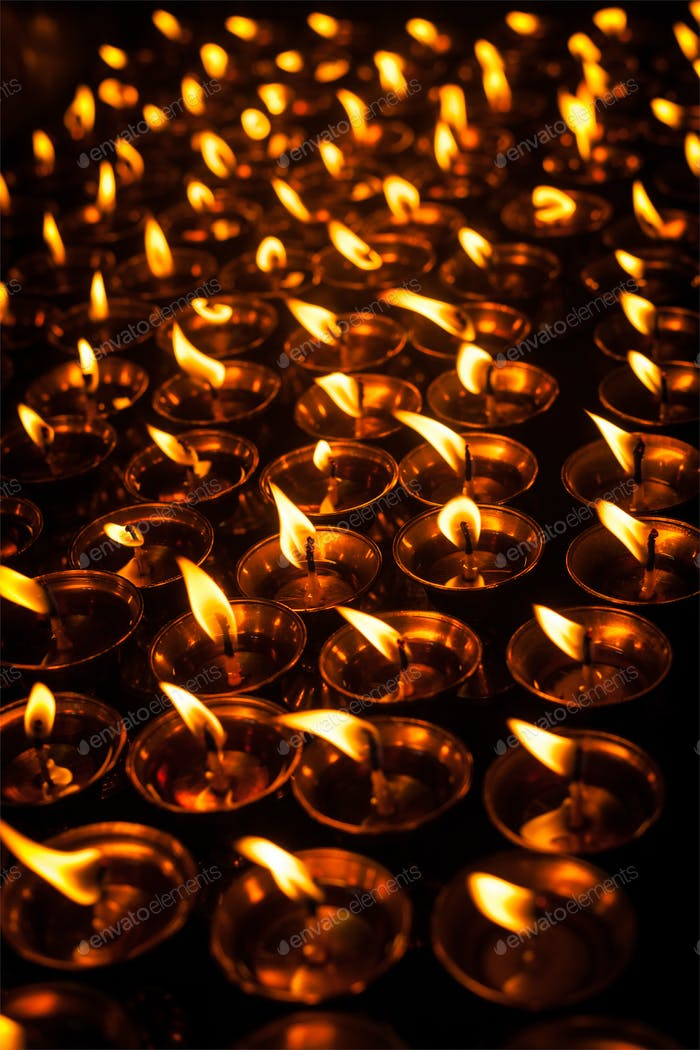 Burning candles in Tibetan Buddhist temple