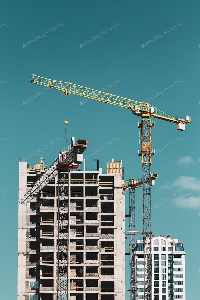 Construction Crane Is Involved In Construction Of A New Multi-st