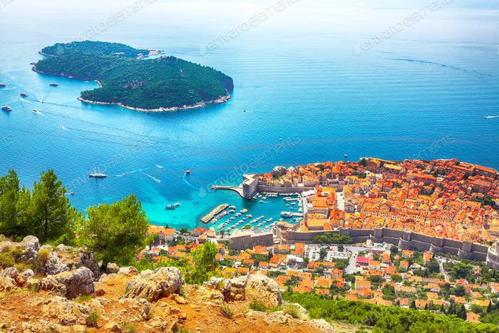 Aerial panoramic view of Lokrum island and Old Town of Dubrovnik on a sunny da