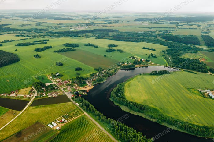 view from the height of the Lake in a green field in the form of a horseshoe and a village in the