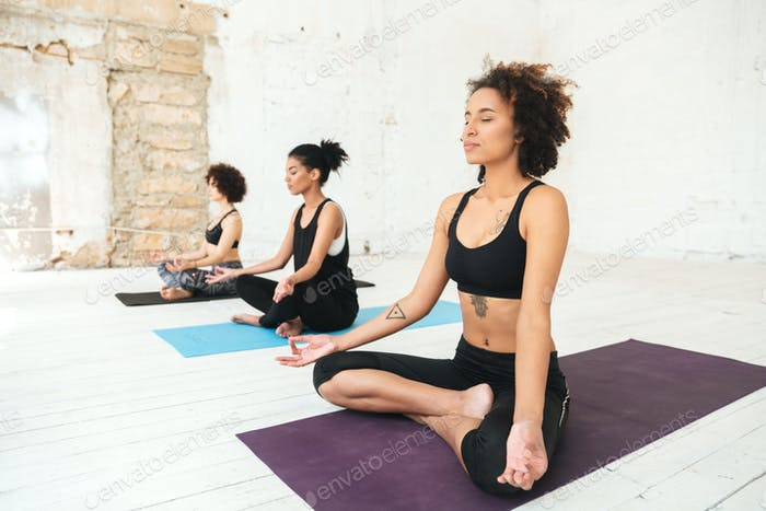 Group of women sitting on a yoga mats
