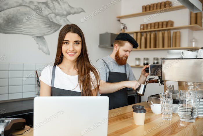 Coffee Business Concept - beautiful caucasian bartender barista or manager working and planing in