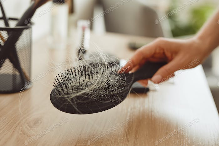 Close Up of Brush with Hair