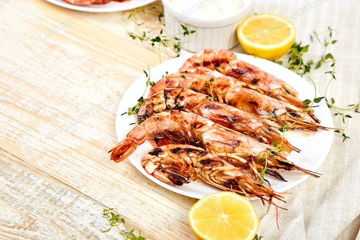 Grilled big tiger shrimps prawns on white plate