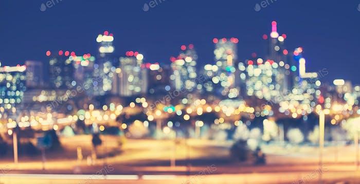 Vintage toned blurred Denver city lights at night.