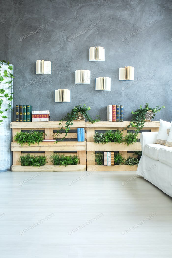 Bookshelf made of pallets in room