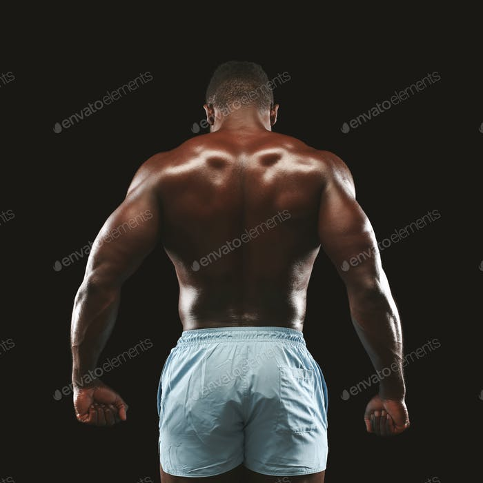 African american sportsman showing strong back muscles