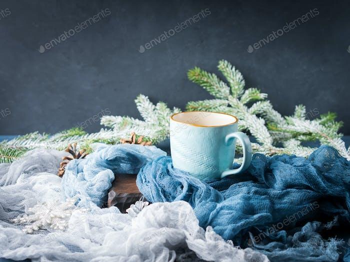 Mug of coffee and milk on dark winter background