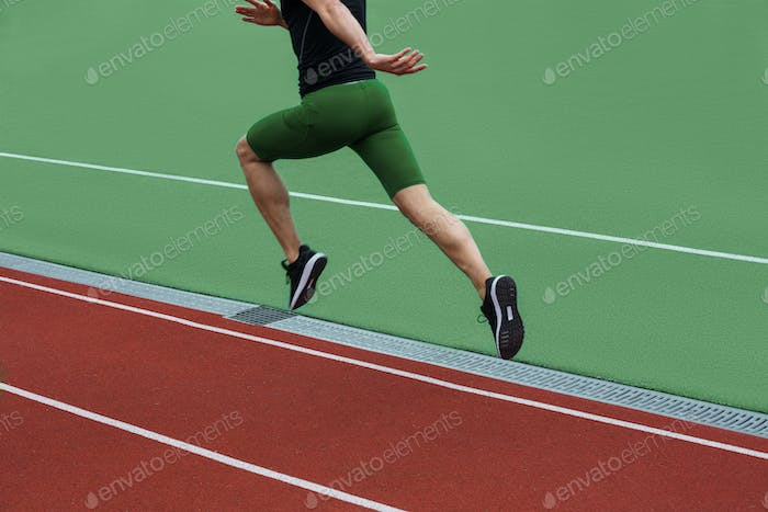 Cropped image of young caucasian athlete man run