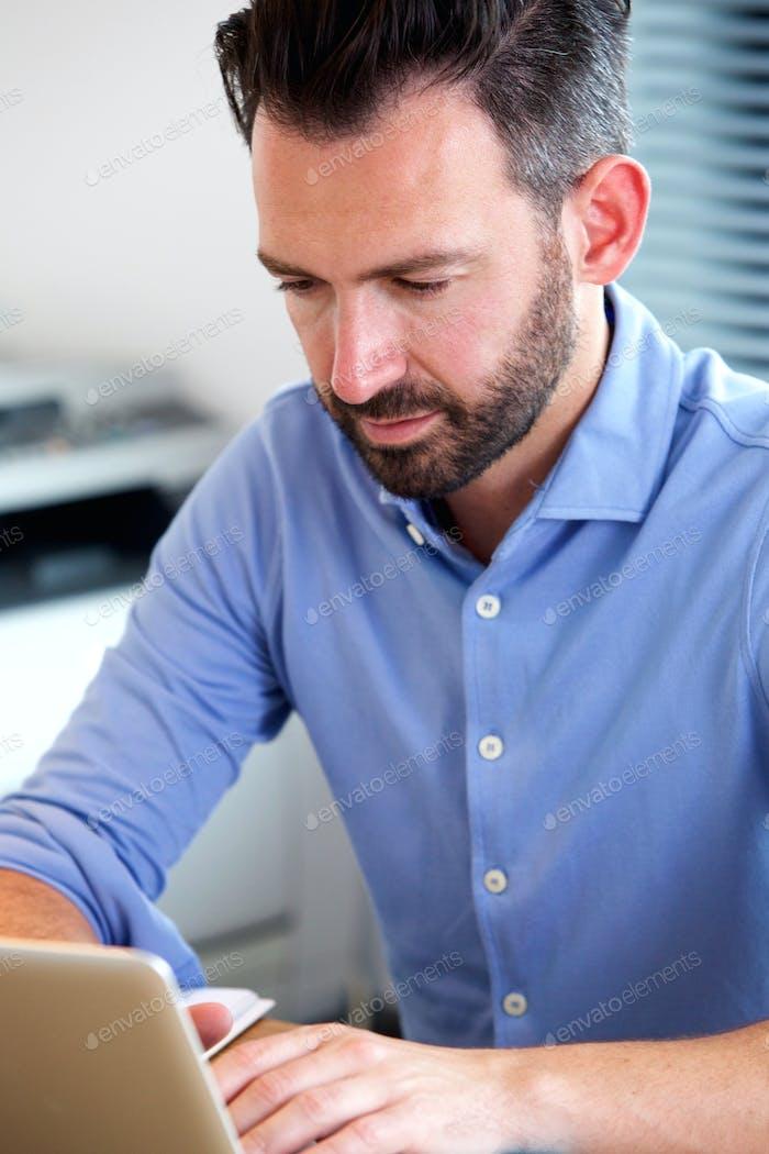 Mature man working on laptop