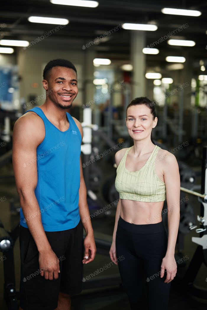 Mixed-Race Couple Posing in Gym