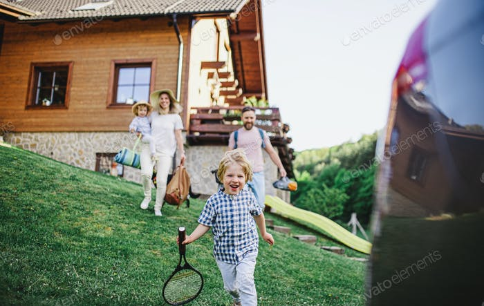 Family with two small children going on trip in countryside