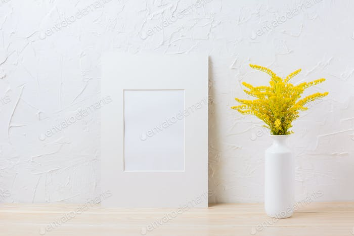 White mat frame mockup with ornamental yellow flowering grass in
