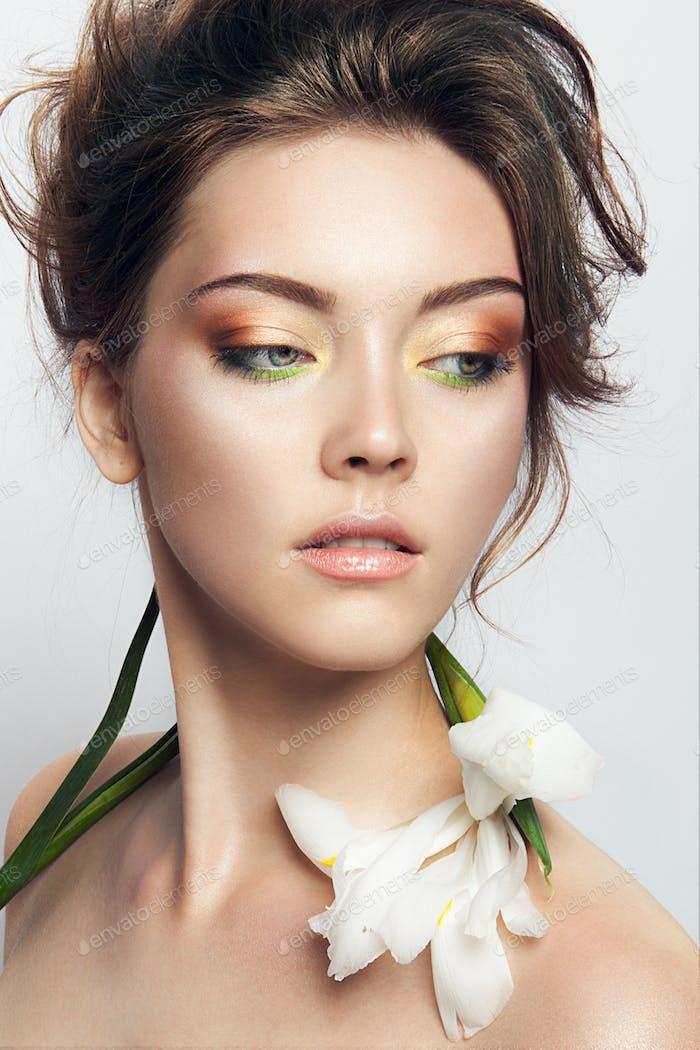 Close-up studio portrait of beautiful woman