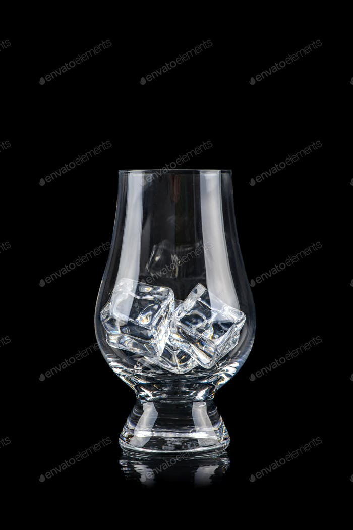 Glass for alcoholic drinks with cun ice on black