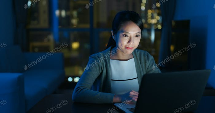 Woman use of computer at home