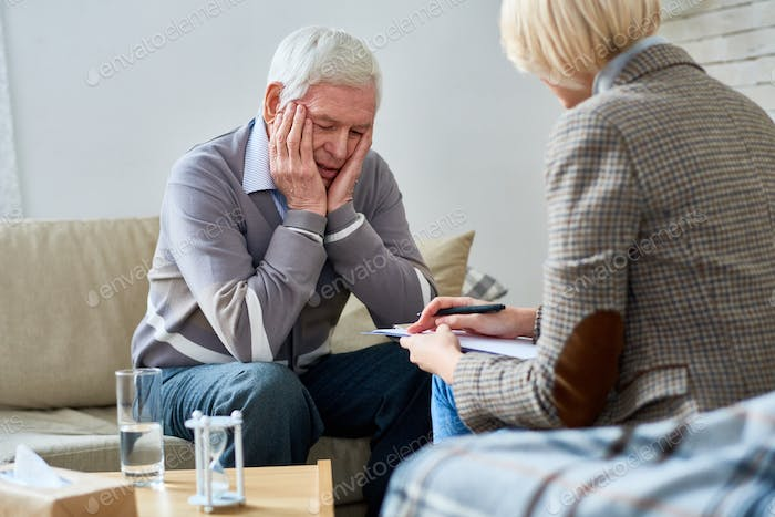 Therapist Consulting Senior Patient