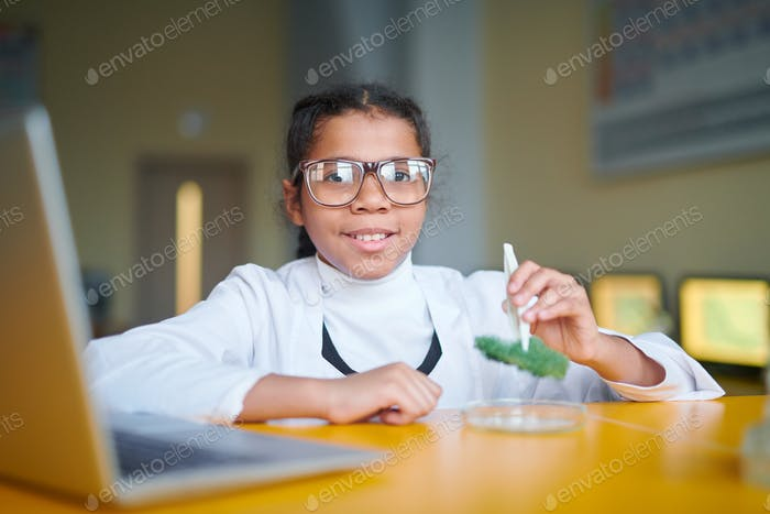 Girl at chemistry lesson