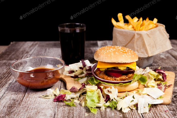 Delicious burger on wooden plate