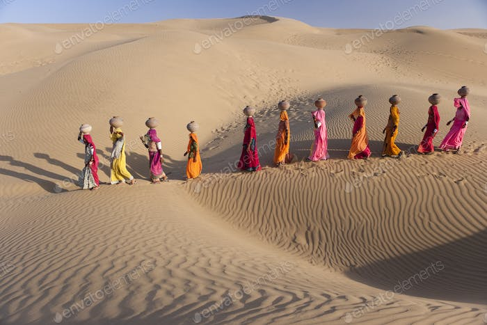 Women bear the responsibility of fetching water from the sparse wells within Rajasthan's vast Thar