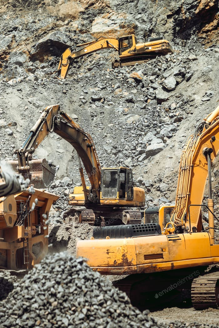 open pit ore mine. Close up details of industrial excavator working on site
