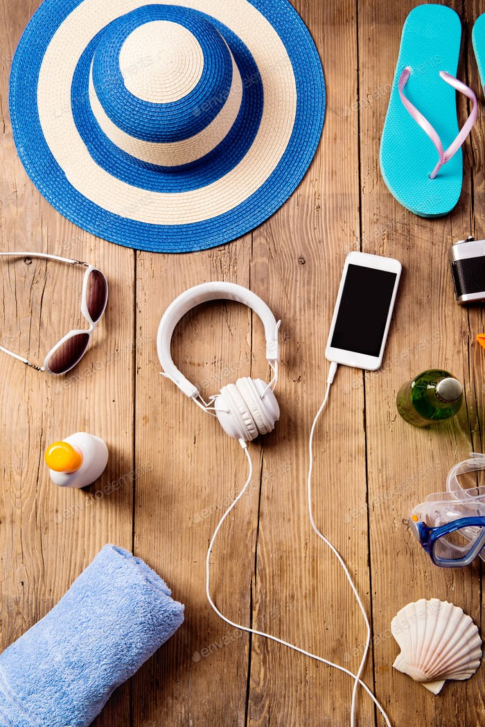 Summer vacation composition. Hat, earphones, smartphone.
