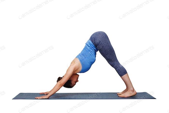 Woman doing Ashtanga Vinyasa yoga asana Adhomukha svanasana