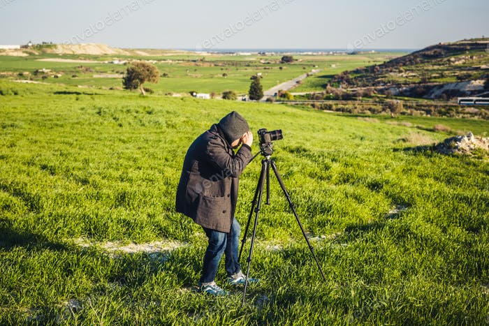 photographer or traveller using a professional DSLR camera