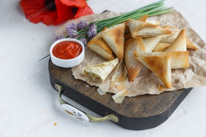 Delicious filo pastry pies with potato and tuna