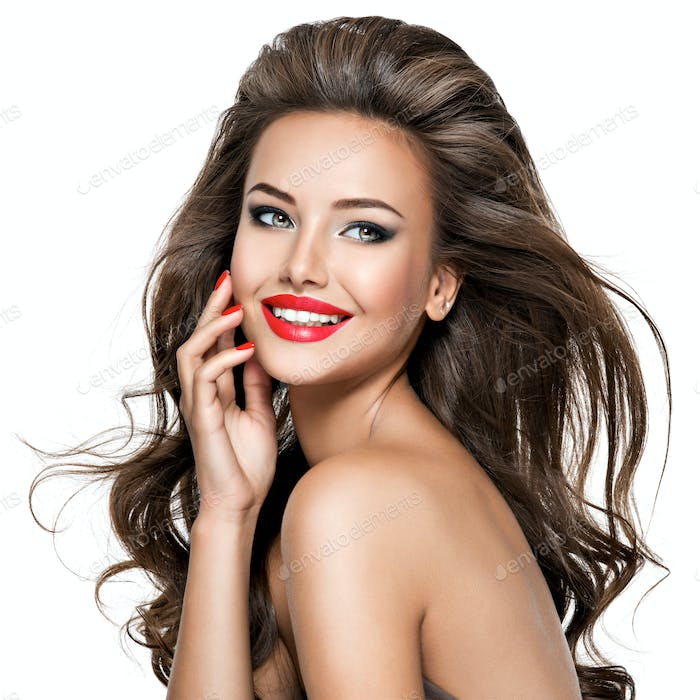 Portrait of  beautiful smiling woman with long brown hair.