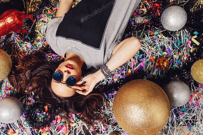 Glamorous party girl wearing sunglasses