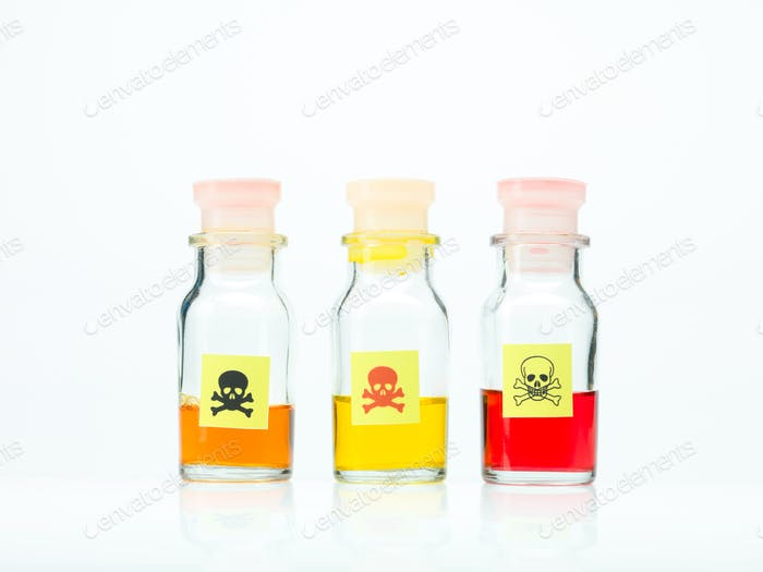 colored poisonous liquid in three different bottles