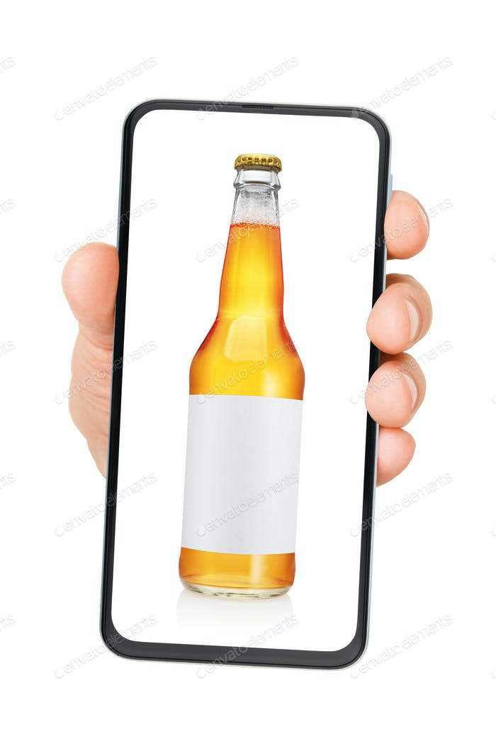 Hand holding smartphone with beer bottle on the screen isolated.