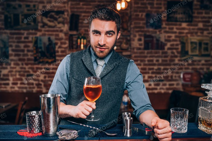 expert bartender presenting Signature drink at local pub, bar or restaurant