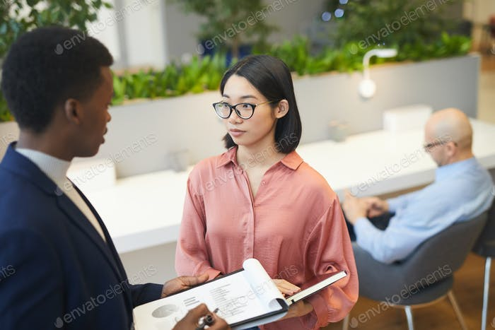 Asian Businesswoman Talking to Manager