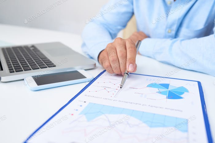 Financial manager analyzing report
