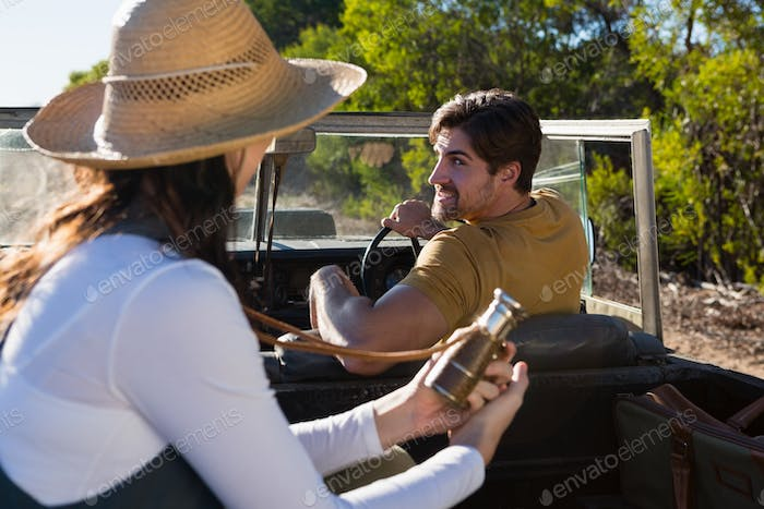 Man with woman in off road vehicle
